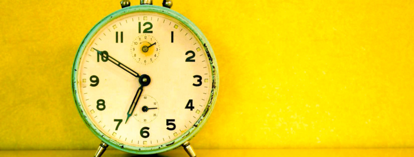 clock against a yellow background